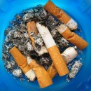ashtray overflown by old stubs